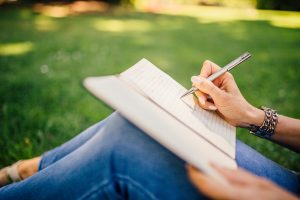 writing a gratitude journal in nature